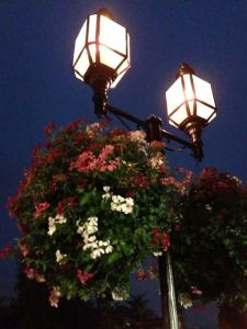 streetlamp hung with flowers